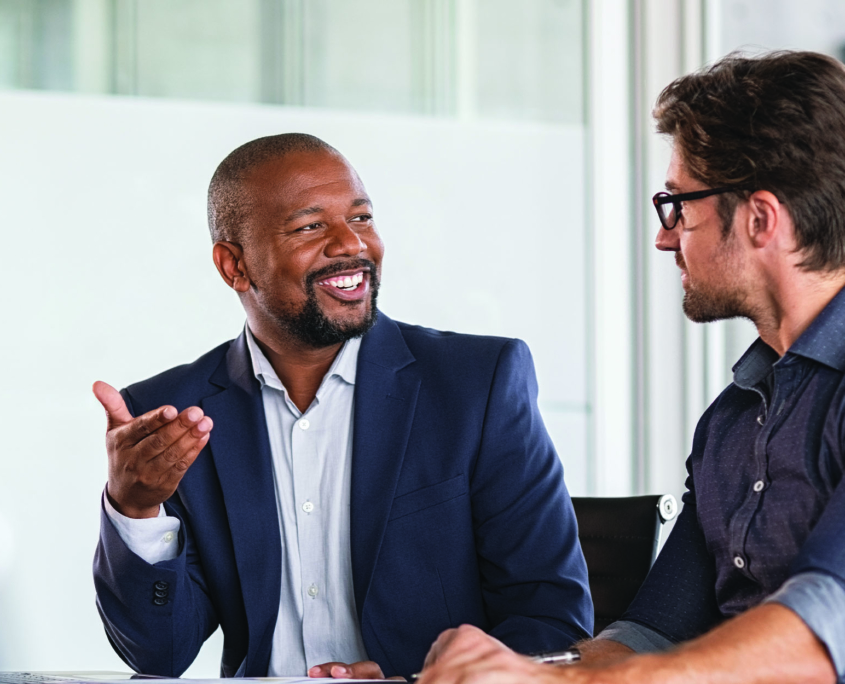 Two business professionals smiling and talking