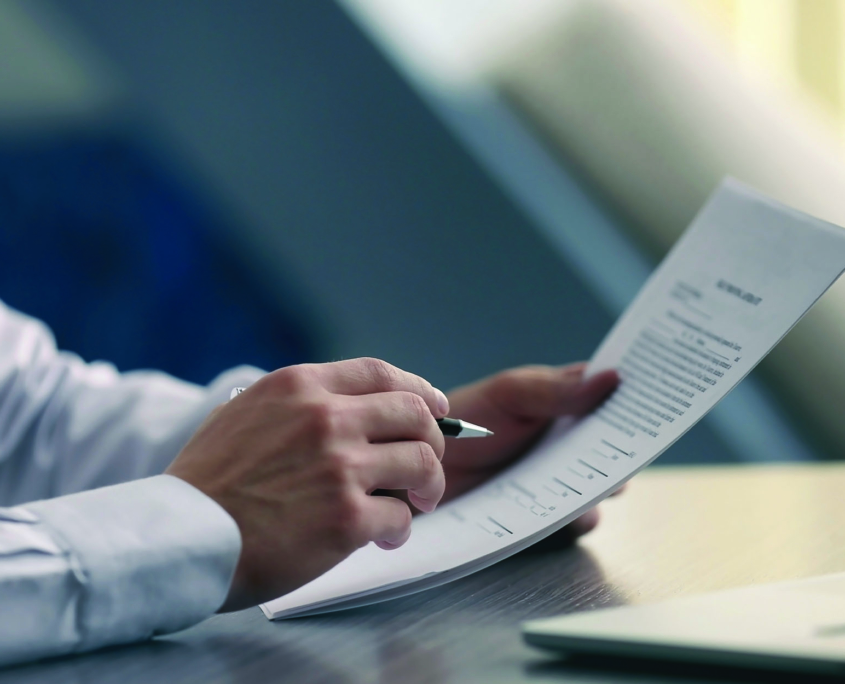 Business person looking at paperwork